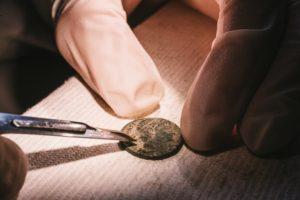 close up of conserving a coin