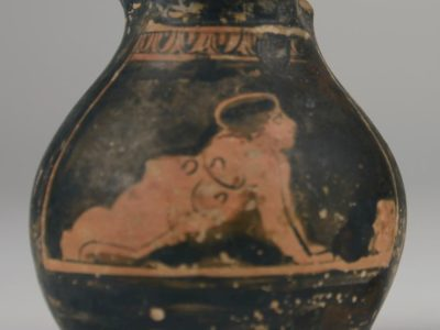 a small red figure ware wine jug called an oinochoe or chous.