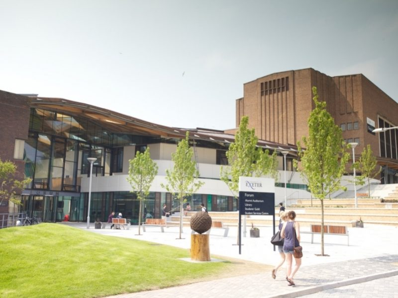 Colour photograph of Exeter University's Forum building, with two students walking past