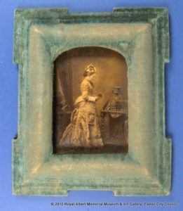Yellowish coloured photograph of a Victorian woman in a blue-coloured frame