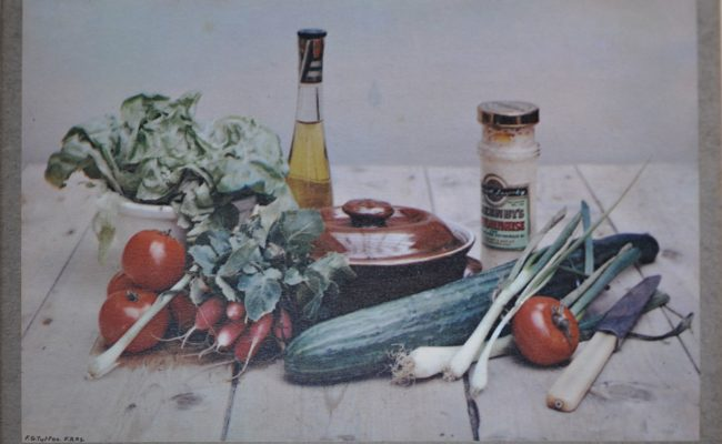Image of a colour photograph 'A Domestic Affair' of colourful vegetables and kitchen utensil showing the artist's signature on the print