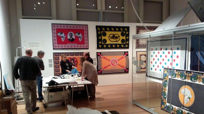 staff in the gallery setting up the exhibition