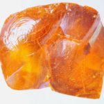 Angular lump of amber-coloured kauri gum from RAMM's economic botany collection