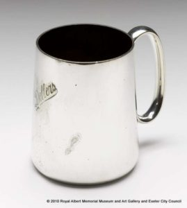 Silver coloured mug, rescued from the destroyed Dellers Cafe after the Exeter Blitz